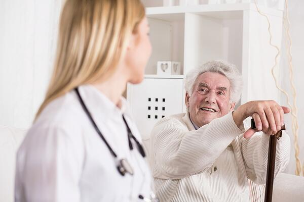 Photo of patient with walking problem and doctor